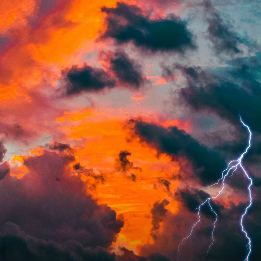image of lightning in the sky at sunset